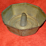 Vintage tin cake pan and Wear-ever strainer