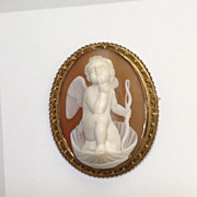 Museum Quality Shell Cameo of a Pensive Eros in a Clam Shell