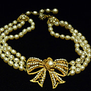 Three-Strand Miriam Haskell Faux Pearl Bow Necklace.