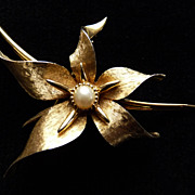 Goldtone Boucher Flower Pin with Faux Pearl.
