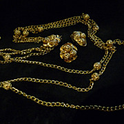 Three-Strand Signed Sherman Goldtone Necklace and Earring Set.