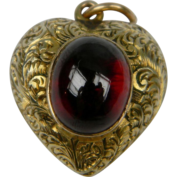 Garnet heart pendant with a glass locket section to reverse