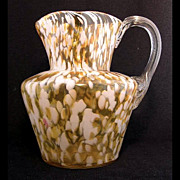 "Phoenix art glass white-butterscotch spatter amber optic pitcher, 8"" h."