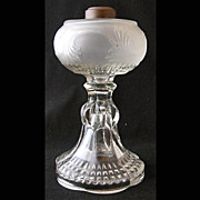"Frosted pattern glass oil lamp, 9 3/4"" h."