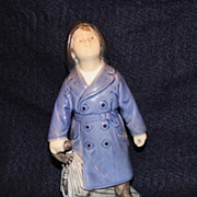 Royal Copenhagen Figurine #3556 - Boy with Umbrella