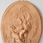 19s Century Earthenware plate sculpted in low relief figuring a 2 birds in the clouds
