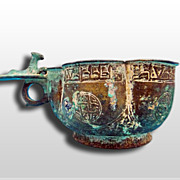 A Seljuk Bronze Lobed cup with layed lion on ringed handle 12th Century