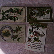 "Vintage Christmas Postcards with ""Good Luck"" motifs embossed"