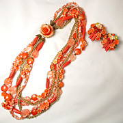 Vintage Carved Floral Persimmon Colored Art Glass Six Strand Necklace and Earring Set