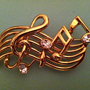 Large Vintage Gold Tone Musical Note Pin With Clear Rhinestones