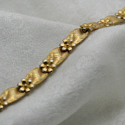 Gold-tone Crown Trifari Floral Motif Bracelet