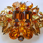 Large, Domed, Multi-leveled Brooch with Warm Rhinestone Colours