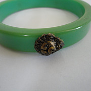 Vintage Green Plastic Bracelet with Lions Heads
