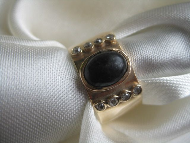 Gold Band with Black Onyx Cabachon and Diamonds