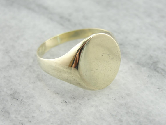 simple antique signet ring in 14k green gold from