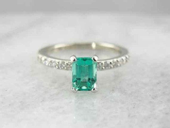 Emerald Engagement Ring With Pave Diamond Accents from marketsquarejewelers o