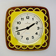 Vintage German Ceramic Wall Clock from Junghans made in the 1970's.