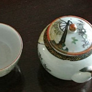 Individual Kutani side-handled teapot and teacup