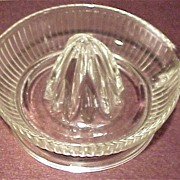 A Vintage Glass Fruit Reamer with Handle and Pour Spout.