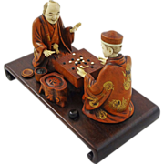 Japanese Ivory and Wood Okimono Group of Two Men Playing a Board Game - c. Meiji (1868-1912),