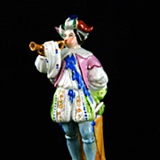 Porcelain Figurine of Man Blowing a Horn