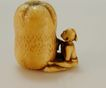 Hand Carved Ivory Netsuke of Man with Giant Gourd c. 19th C.