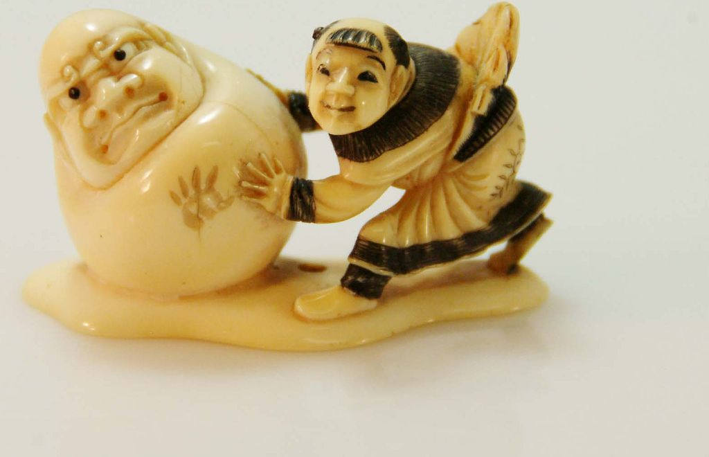 Hand Carved and Signed Ivory Netsuke of Man With a Snowman c. 19th Century