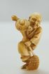 Carved Ivory Netsuke of Man with Broom and Teapot with Mouse c. 19th C.