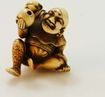 Hand Carved Ivory Netsuke of Man with Child on Back c. 19th C.