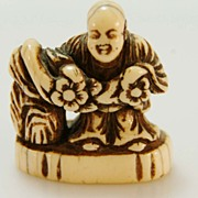 Carved Ivory Netsuke of Man with Flowers c. 19th C.
