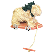 Teddy bear on a wheeled platform