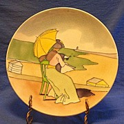 Majolica Plate Of A Woman Sitting On A Hill
