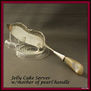 Jelly roll or cake knife server with mother of pearl handle
