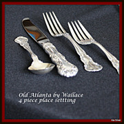 Old Atlanta four-piece place setting in sterling by Wallace