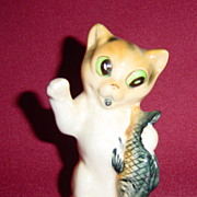 Japan Cat Holding a Fish Figurine