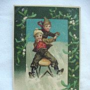 SALE Christmas Postcard Two Boys Sledding Down Hill