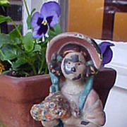 SALE Cast Iron Doorstop Girl In Bonnet Holding Flowers