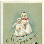 Little Girls in White with Fur Muffs Christmas Postcard