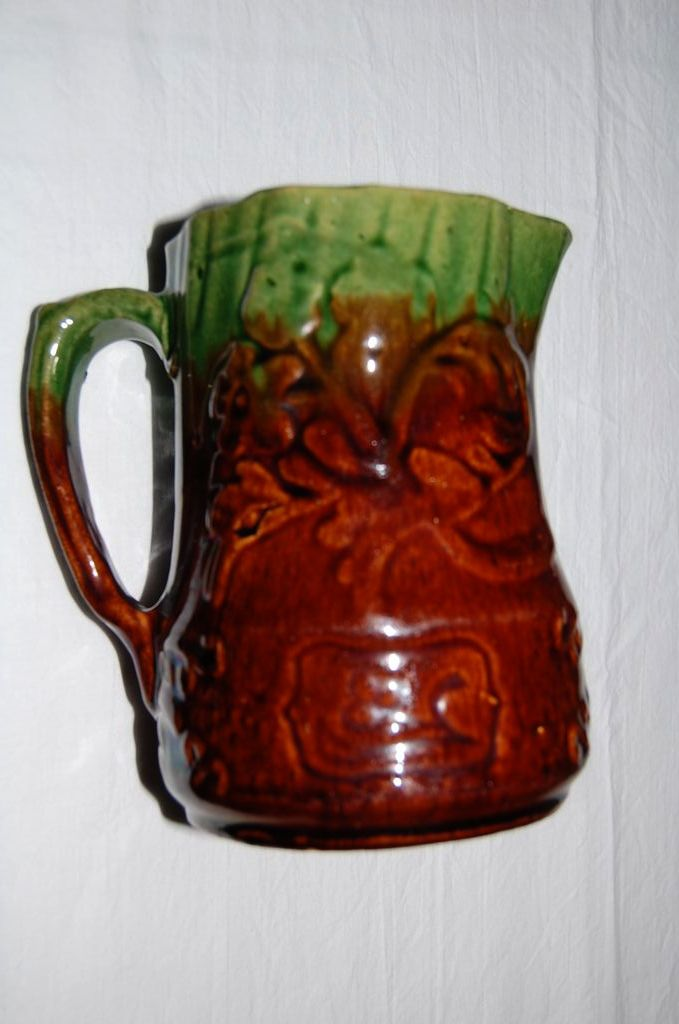 Early 1900's Glazed Pottery Pitcher with Raised Floral Design