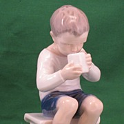 B&G Victor Figurine sitting on a stool drinking milk Bing & Grondahl