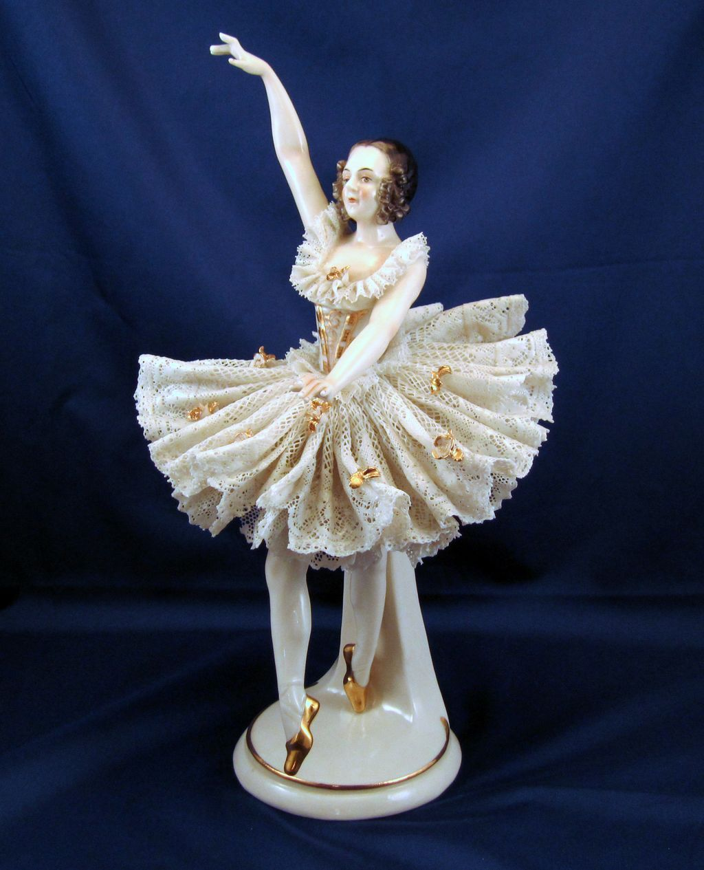 Dresden lace ballerina figurine in a graceful pirouette