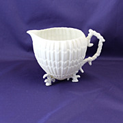 Rare footed Limpet Belleek Creamer with coral feet and handle