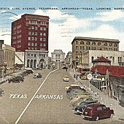 Postcard of the Borders of Texas and Arkansas State Line Avenue Texarkana