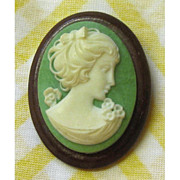 Green and White Cameo on Wood Base
