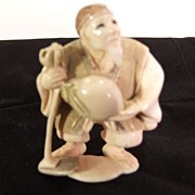 Well Carved Ivory Netsuke of a Farmer