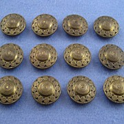 Twelve Vintage Brass-tone Steel Buttons