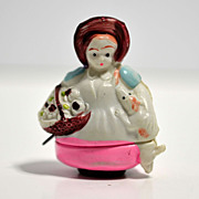 Figural Japanese celluloid tape measure  lady with dog