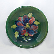 Moorcroft dish  anemone with green background