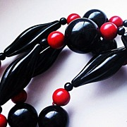 SOLD Vintage Carol Dauplaise Rope Necklace Red & Black Lucite Swirl