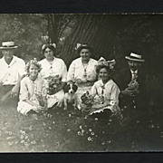 Real Photo Postcard Group of Men, Women & a Dog with Daisies